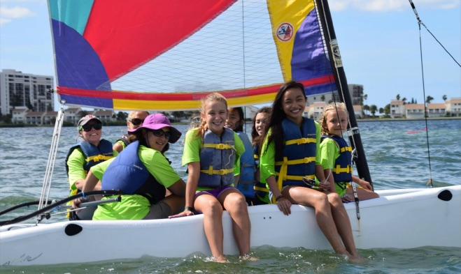 Kids on a sailboat at annual pirate camp